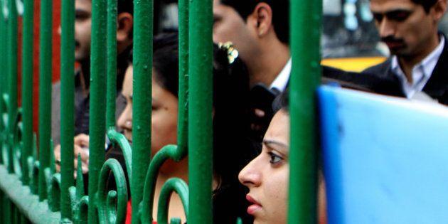 NEW DELHI, INDIA - JANUARY 2: Anxious parents standing in queue at Raghubir Singh Junior Modern School...