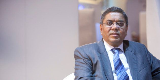 Tulsi Tanti, chairman of Suzlon Energy Ltd., poses for a portrait at the World Economic Forum (WEF) Annual...