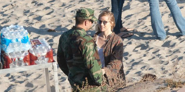 LOS ANGELES, CA - JUNE 04: Bradley Cooper and Suki Waterhouse are seen on the set of 'American Sniper'...