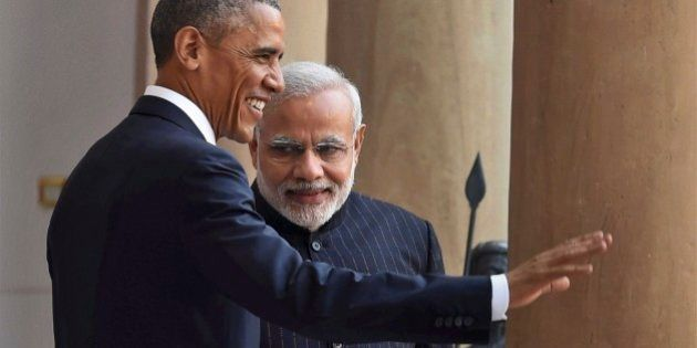 U.S. President Barack Obama, left and Indian Prime Minister Narendra Modi pose for the media before they...
