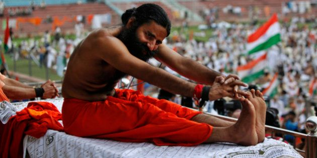 Indian yoga guru Baba Ramdev stretches during an anti-corruption protest in New Delhi, India, Tuesday,...