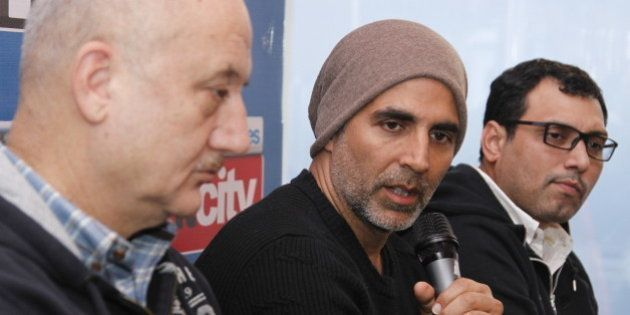 NEW DELHI, INDIA - JANUARY 19: Bollywood actors Anupam Kher and Akshay Kumar with director Neeraj Pandey...