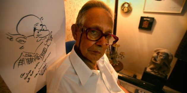 INDIA - NOVEMBER 06: RK Laxman, Cartoonist with a sketch of his most famous character 'Common Man' at...