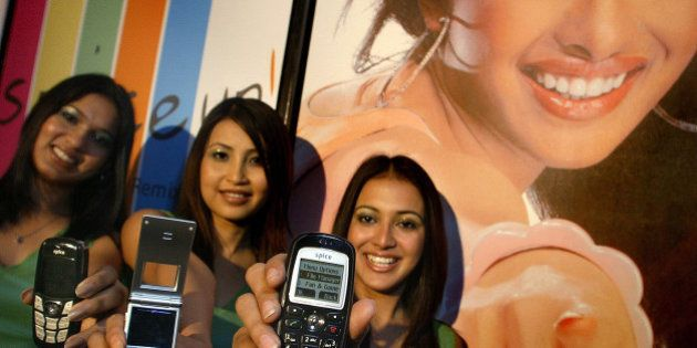 Models pose with Spice mobile handsets at the launch of the product in New Delhi, India, Tuesday, June...
