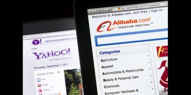 The Yahoo! Inc. and Alibaba Group Holding LTD. websites are displayed on computer monitors for a photograph...