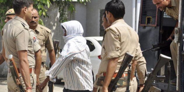 GHAZIABAD, INDIA - SEPTEMBER 17: Nithari rapist-cum-serial killer Surinder Koli being taken back to Dasna...