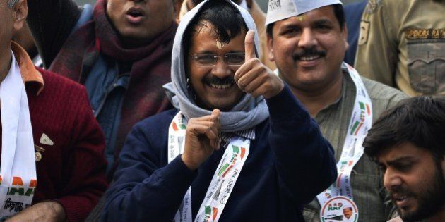 Indian political party Aam Admi Party (AAP) party chief Arvind Kejriwal greets supporters during a road...