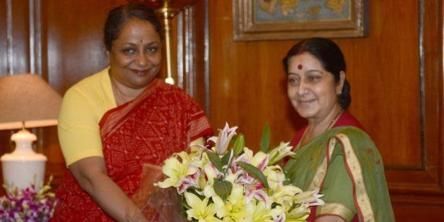 India's newly appointed Minister of External Affairs Sushma Swaraj (R) is welcomed by Indian Foreign...