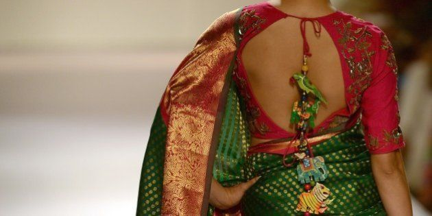 An Indian model showcases a creation by designer Gaurang on the third day of the Lakme Fashion Week (LFW)...