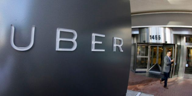In this photo taken Tuesday, Dec. 16, 2014, a man leaves the headquarters of Uber in San Francisco. (AP...