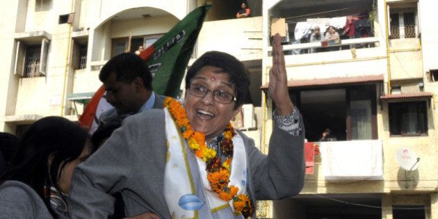 NEW DELHI, INDIA JANUARY 29: BJP Chief Ministerial Candidate Kiran Bedi waves to voters during the campaigning...