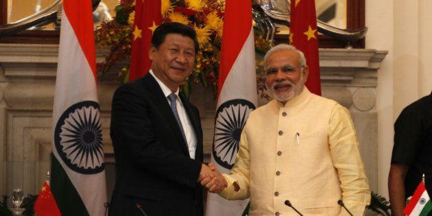 NEW DELHI, INDIA - SEPTEMBER 18: Prime Minister Narendra Modi and Chinese President Xi Jinping shake...