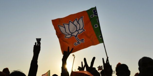 Indian supporters of the right-wing Bharatiya Janata Party (BJP) gesture at a public rally addressed...