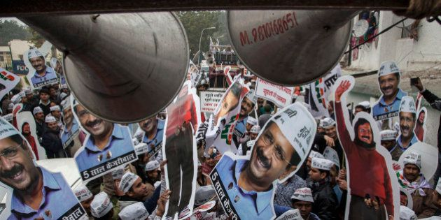 Aam Aadmi Party (AAP), or Common Man's Party supporters carry portraits of party chief Arvind Kerjiwal...