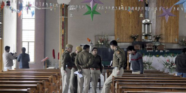 NEW DELHI, INDIA - FEBRUARY 2: Delhi Police officers investigate after attack on St Alphonsas church...