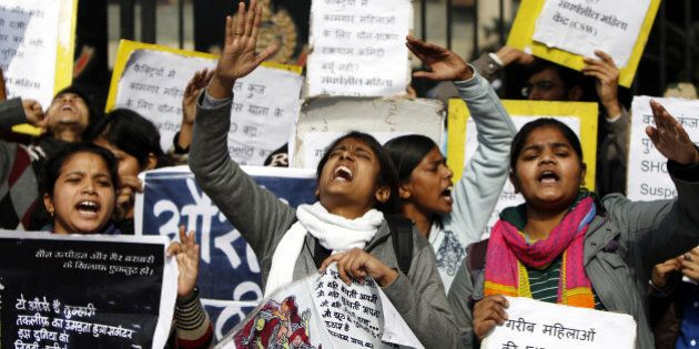 NEW DELHI, INDIA - JANUARY 13: Women protesters shouts slogans during a protest outside Delhi police...
