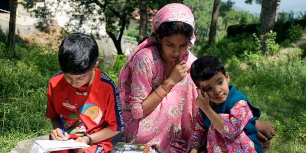 Kids studying in a village, Kasauli, Himachal Pradesh, India. (Photo by: IndiaPictures/UIG via Getty