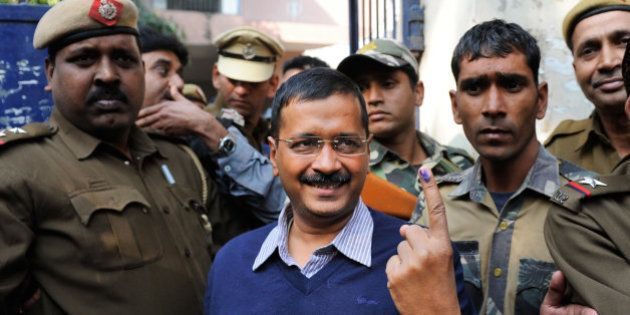Aam Aadmi Party, or Common Man's Party, leader Arvind Kejriwal displays the indelible ink mark on his...