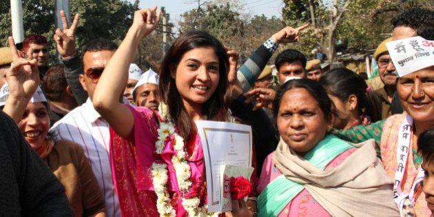 DELHI, INDIA - 2015/02/10: Aam Aadmi Party Leader Alka Lamba celebrate her win in Delhi Assembly Election...