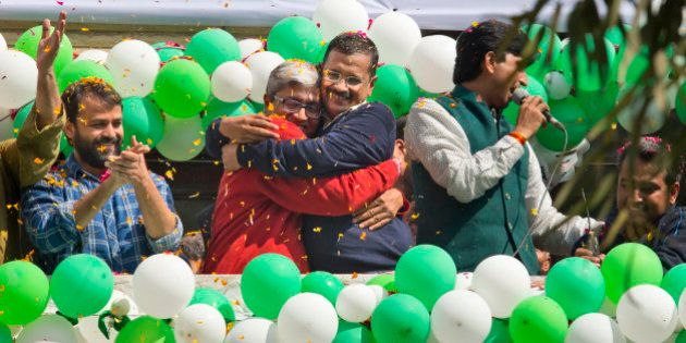 Aam Aadmi Party, or Common Man's Party, leaders Arvind Kejriwal, center, and Ashutosh, second left,...