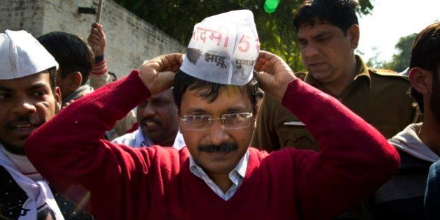 Aam Aadmi Party, or Common Man Party, leader Arvind Kejriwal, adjusts his cap while campaigning ahead...
