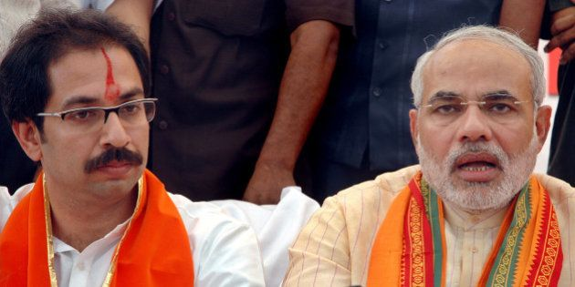 Leader of Hindu nationalist party Shiv Sena Uddhav Thackeray, left, and Chief Minister of Gujarat state...