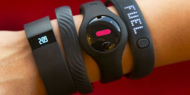 Four fitness trackers are shown in this photograph, in New York, Monday, Dec. 16, 2013. They are, from...