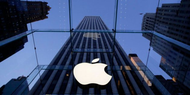 FILE - In this Sept. 5, 2014 file photo, the Apple logo hangs in the glass box entrance to the company's...