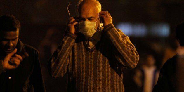 NEW DELHI, INDIA - FEBRUARY 17: A man wearing a mask as a precaution measure against swine flu virus,...