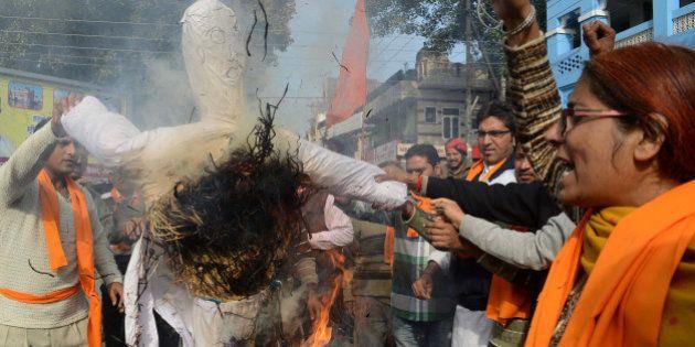 Activists of Vishva Hindu Parishad (VHP), Bajrang Dal and The Durga Vahini (Army of Durga) shout slogans...
