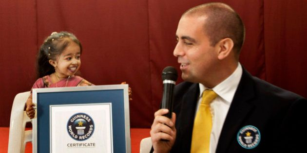 Guinness World Records adjudicator Rob Molloy, right, confers the title of the shortet woman of the world...