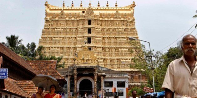 FILE- In this Tuesday, July 5, 2011, devotees leave the 16th-century Sree Padmanabhaswamy Temple in Trivandrum,...