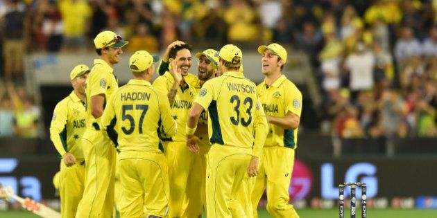 Australia's Mitchell Johnson center, is congratulated by team mates after taking a wicket during their...