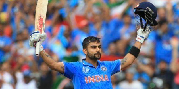 India's Virat Kohli, celebrates his hundred runs during the World Cup Pool B match against Pakistan...