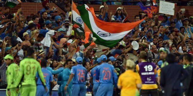 Spectators celebrate India's victory over Pakistan in the Pool B 2015 Cricket World Cup match between...