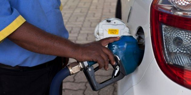 A man fills diesel in a car at a fuel station in New Delhi, India, Sunday, Oct. 19, 2014. India freed...