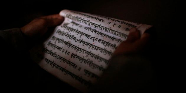 A young student studies Sanskrit scripts while attending class at Budhanilkantha Vedh Vidhya ashram,...