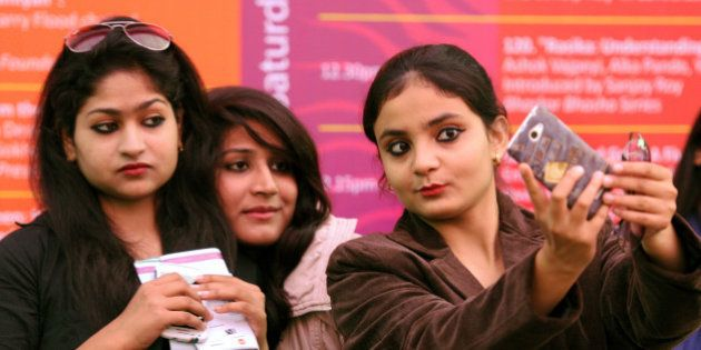 JAIPUR, INDIA - JANUARY 23: Visitors take selfies at the Jaipur Literature festival at Diggi Palace on...