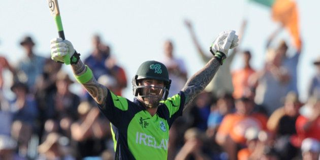 Ireland's John Mooney raises his arms after hitting the winning runs against West Indies during their...
