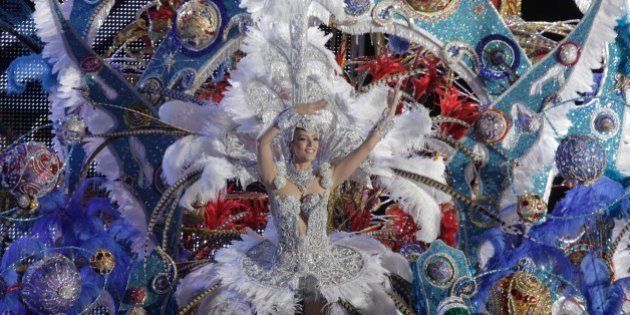 A nominee for Queen of the Carnival of Santa Cruz shows off her outfit on the main stage in Santa Cruz...