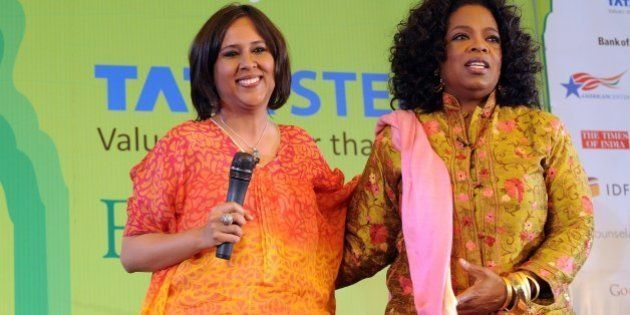 Television talk show host Oprah Winfrey (R) poses with Indian Journalist Barkha Dutt during the Jaipur...