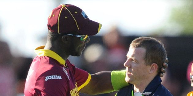Ireland's Niall O'Brien, right, shakes hands with West Indies' Darren Sammy at the end of their Cricket...