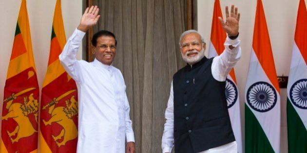 Sri Lanka's President Maithripala Sirisena, left, and Indian Prime Minister Narendra Modi wave during...