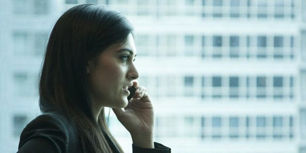 Indian businesswoman talking on cell phone in