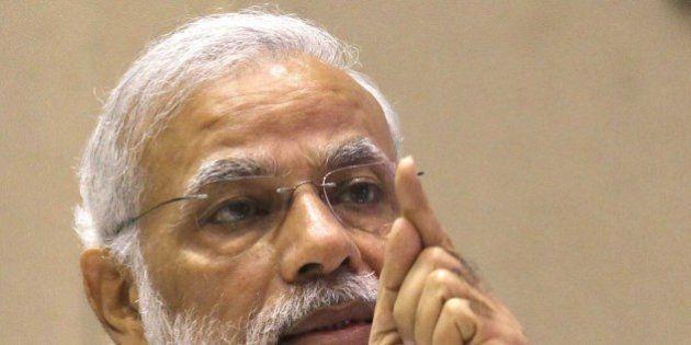 NEW DELHI, INDIA - FEBRUARY 15: Prime Minister Narendra Modi addresses during the Re-Invest 2015, the...