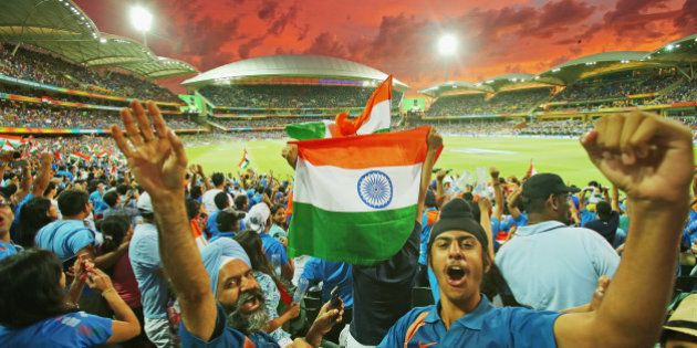 ADELAIDE, AUSTRALIA - FEBRUARY 15: Indian fans in the crowd celebrate as a Pakistan wicket falls as the...