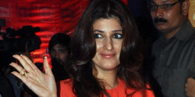 Indian Bollywood actress Twinkle Khanna poses as she attends the opening of a luxury boutique in Mumbai...