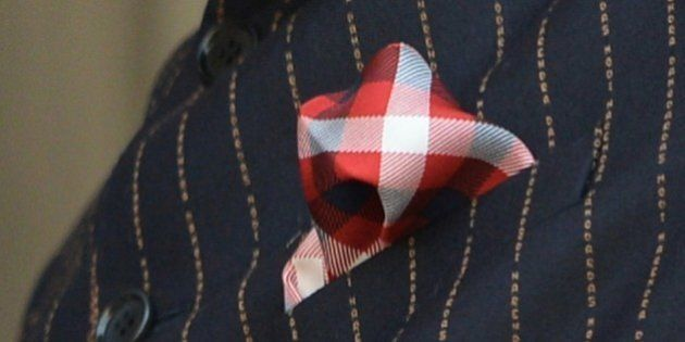 This photograph taken on January 25, 2015, shows detail on Indian Prime Minister Narendra Modi's suit...
