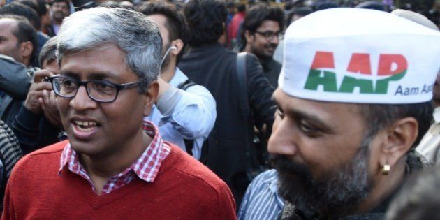 Senior Leader of India's Aam Aadmi Party Ashutosh (C) arrives for a meeting in New Delhi on February...