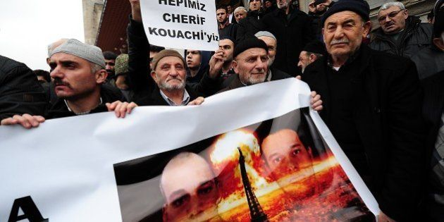 Turkish anti-Charlie Hebdo protesters hold a banner with pictures of Cherif and Said Kouachi (R), two...